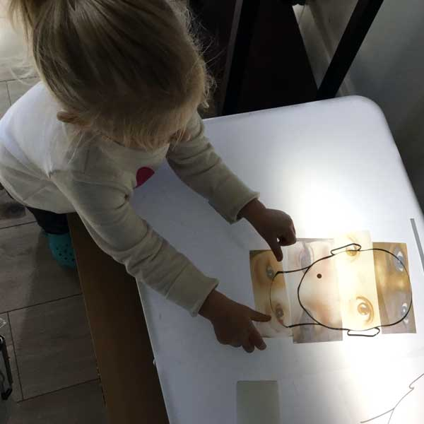 child working on light table
