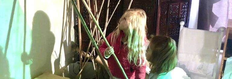 children playing with green shadows